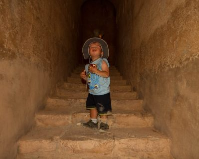 Little boy climbing stairs at Qasr Kharana