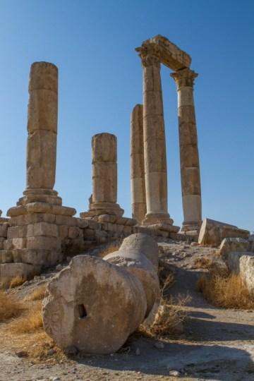 Children in front of fallen pillars at the Temple of Hercules in Amman Jordan