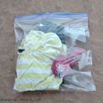 A change of children's clothes in a ziplock bag - Items to Keep Kids Healthy When Travelling