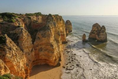 Algarve cliffs rise above the Atlantic Ocean