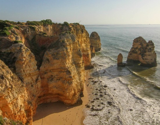 Algarve cliffs rise above the Atlantic Ocean