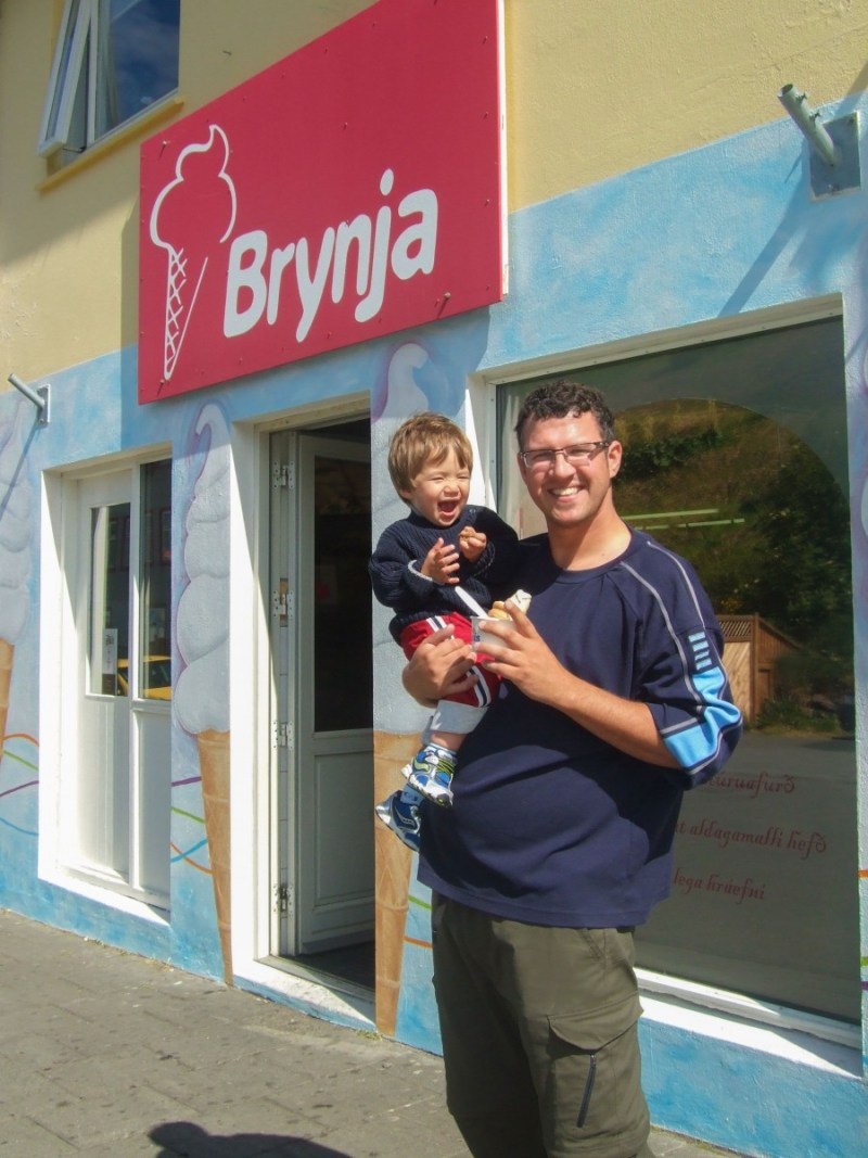 A father and son smile while eating Ice cream in Iceland for kids