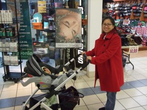 Woman pushes child in a stroller at the mall - helping kids find nap time on the road