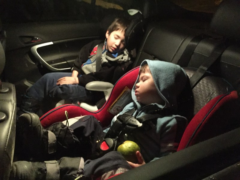 Two children sleep in car seats - helping kids find nap time on the road