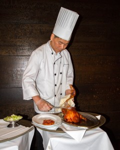 Chef carving duck at New York Peking Duck House