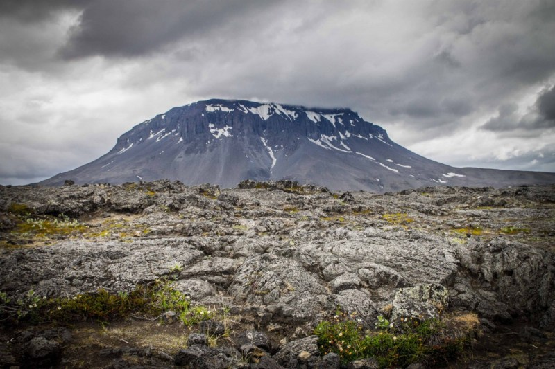 Herdubreid mountain in the Icelandic Highlands is capped with snow amidst it's desolate surroundings.