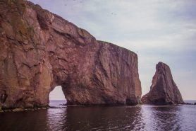 Vew of Perce rock while on a boat of the A must do in the Gaspé Peninsula: Bonaventure Island and Percé Rock.