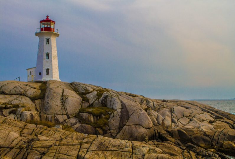 Peggys Point Lighthouse in Peggy's Cove one of our bucket list destinations in Canada.