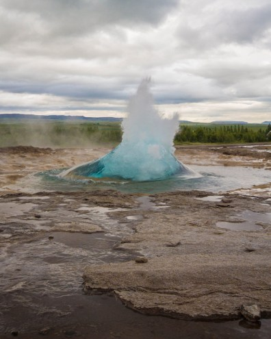 An eruption begins at a geyser in Iceland - An Epic 14 Day Iceland Itinerary