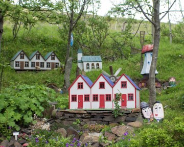 small houses designed for elves sit in a garden in Iceland - An Epic 14 Day Iceland Itinerary