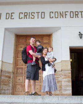 Family posing in front of the church steps in Monserrate, Bogota.