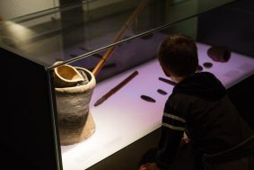 Boy looking at pre-Colombian artifacts at the Gold Museum in Bogota.