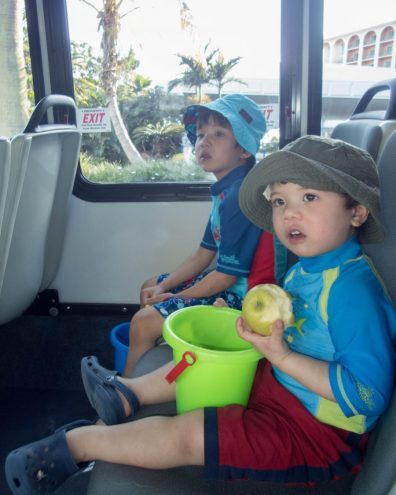 Two boys on shuttle to the beach in Bermuda