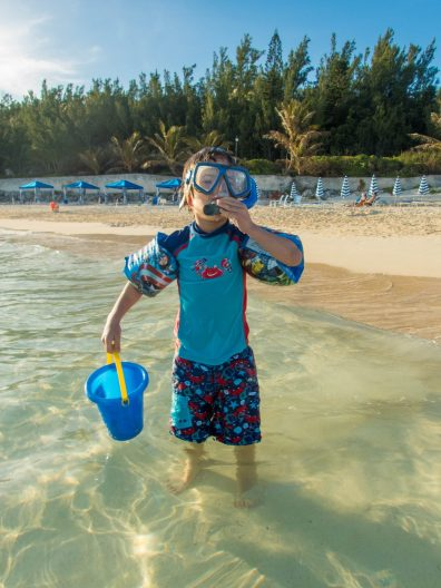 Boy getting ready to snorkel at East Whale Bay to see if it is the best Bermuda beach