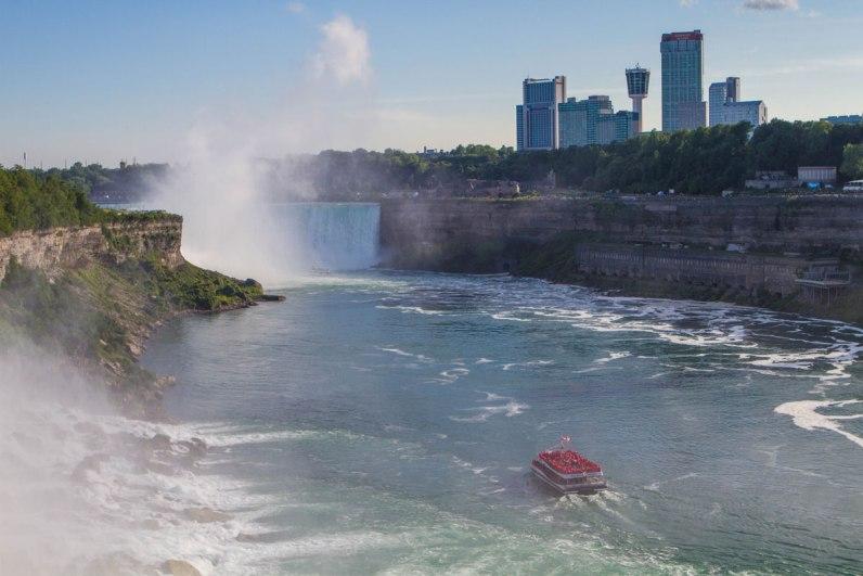 The Hornblower cruise heads towards the Horseshoe Falls in Niagara Falls - Exploring Niagara Falls