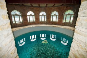 The swimming pool is located in the castle and remains unfinished.