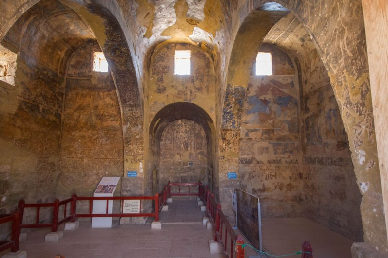 The inside walls of Amra Castle in Jordan are painted in intricate detail