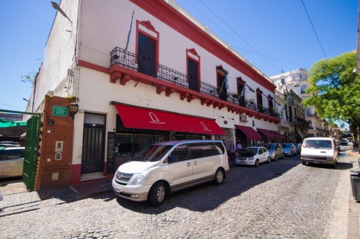 Van parked in cobblestone street in San Telmo.