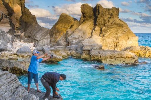Fishermen toss their lines from the rocks near Horseshoe Bay Beach in Bermuda
