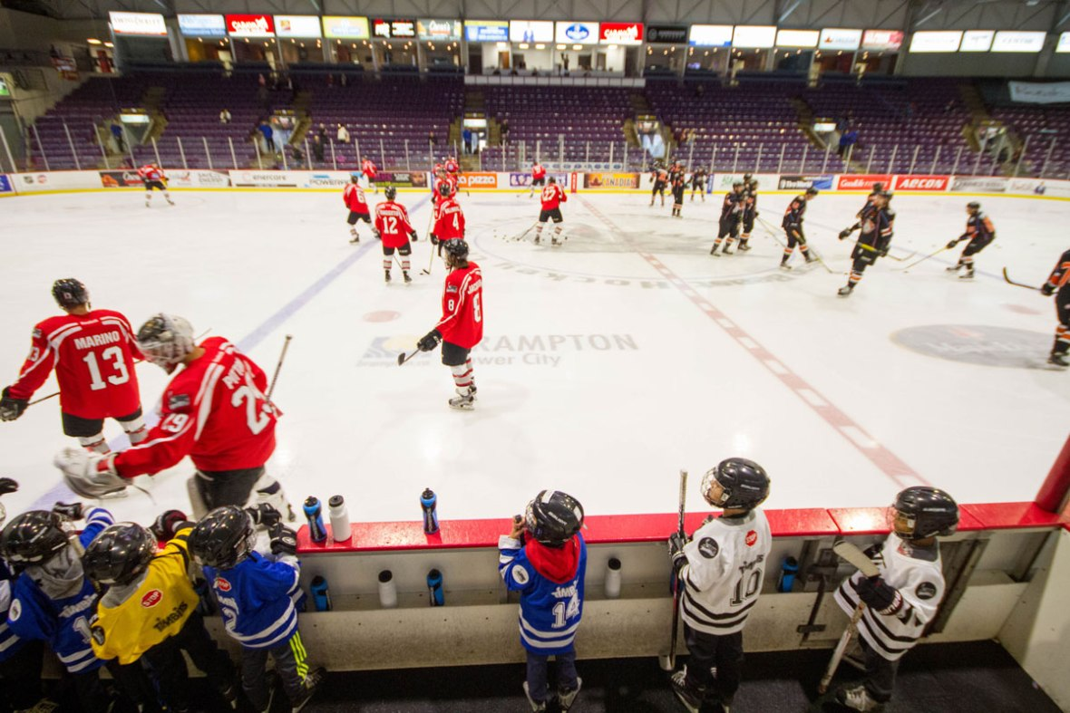 a young boy watches the Brampton Beast play from the bench