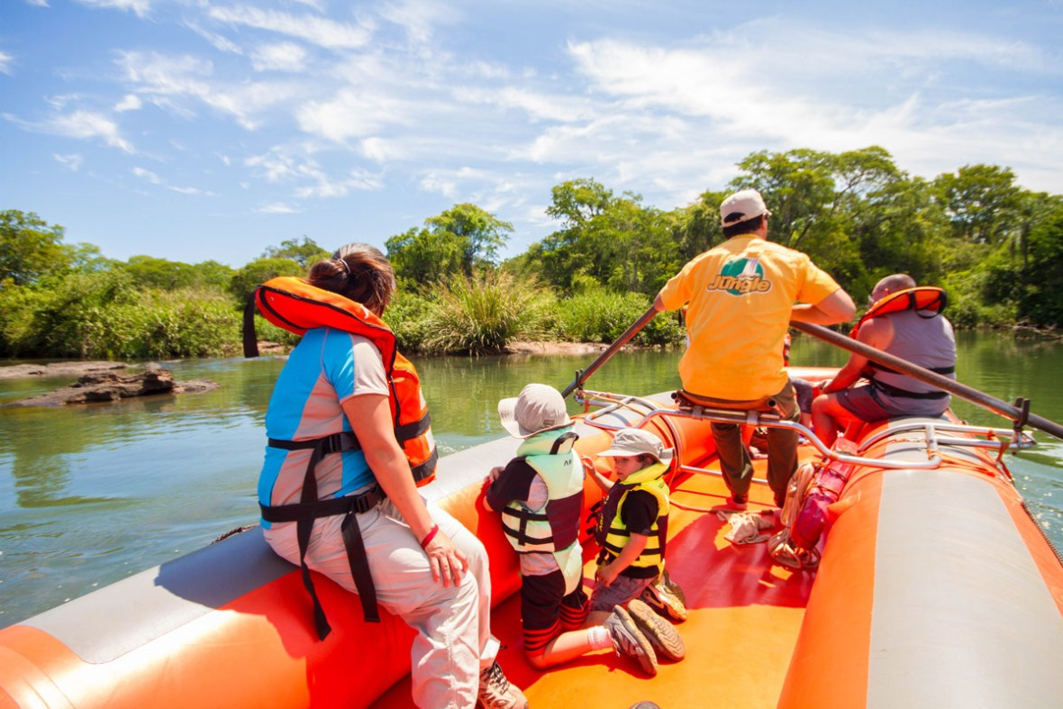 Mother and sons rafting with Iguazu Jungle on Upper Iguazu River on their visit of Iguazu Falls Argentina with kids.
