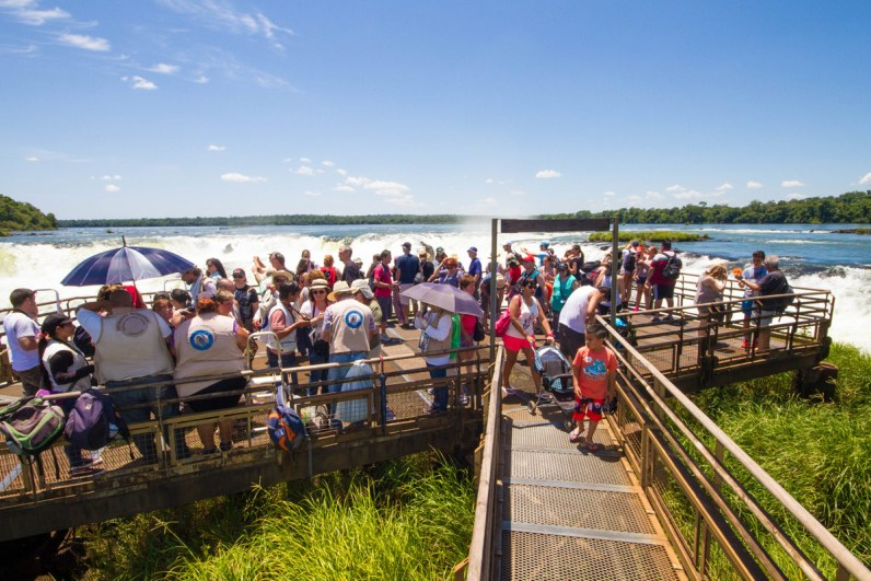 Crowded viewpoint at Devil's Point lookout in Iguazu Falls Argentina.