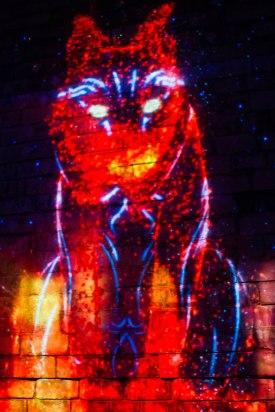 Illuminated image of a bobcat at Lumina Borealis.