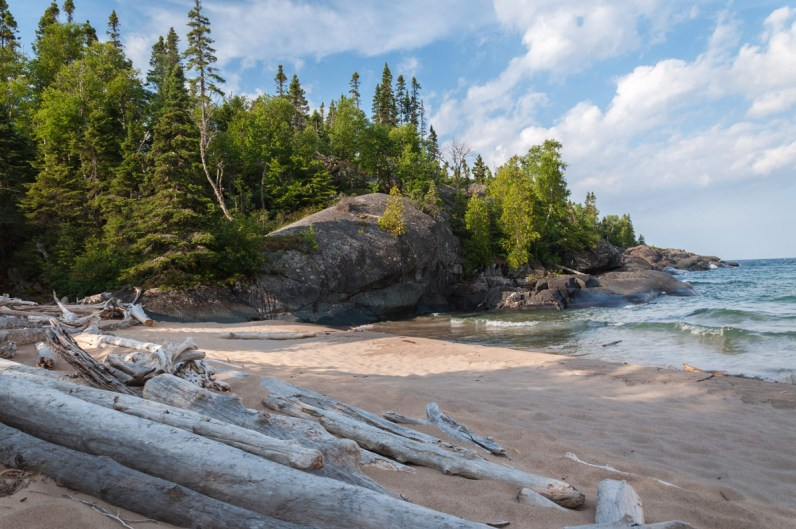 Driftwood on the beach at Pukaskwa National Park, one of the National Parks in Ontario.