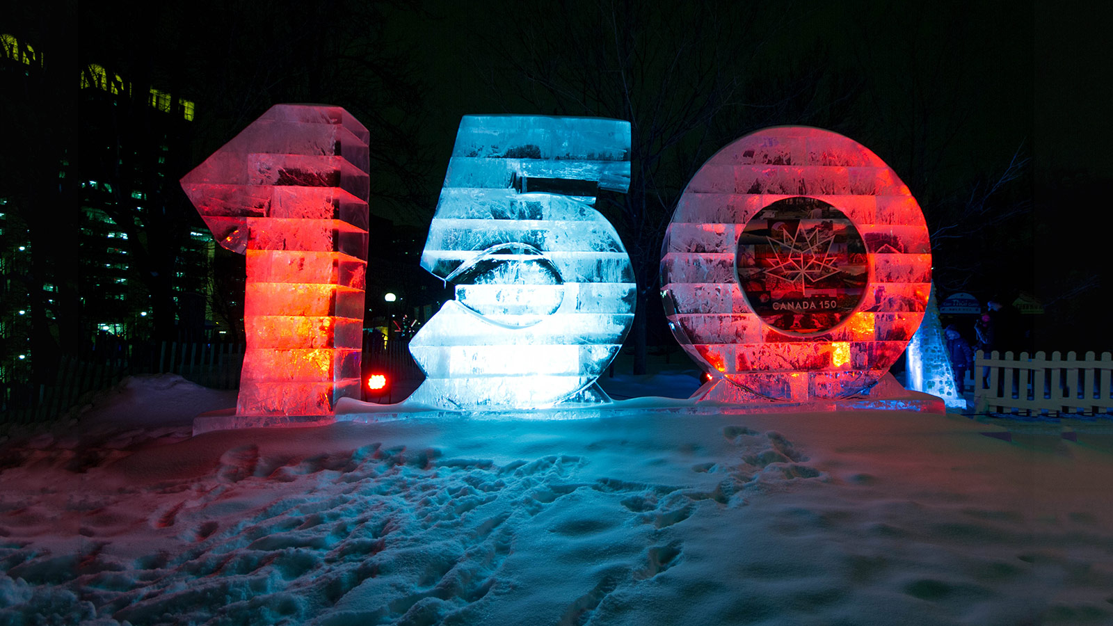 Ice sculpture that reads 150 illuminated in red and white