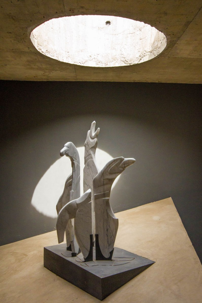 Beautiful concret statue lit through a skylight in the ceiling of the Punta Tombo Penguin Interpretation Center in Argentina