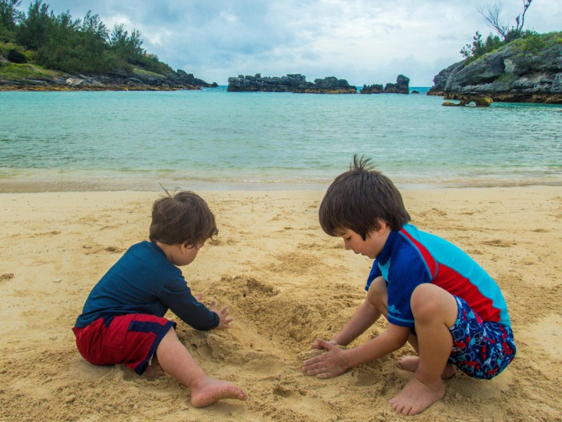 Boys playing in the sands of Tobacco Bay, St George Bermuda.