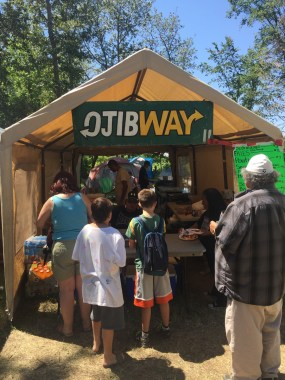 Mock Subway sign saying OjibWay at a food stall at a Pow Wow