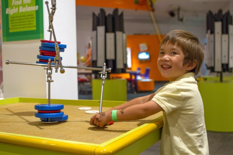 Boy learning about physics at the Museum of Play in Rochester.