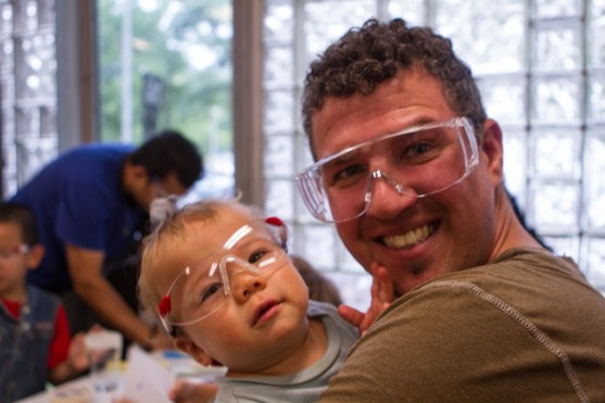 Boy getting used to his safety glasses at the Glass Blowing Workshop in the Corning Museum of Glass.