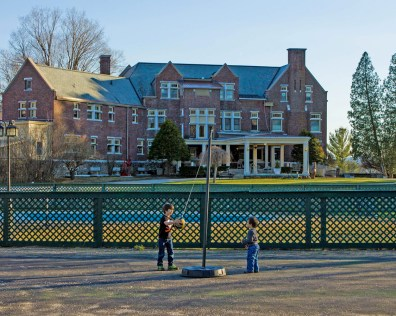 Boys playing dodgeball at the the grounds of the Wilburton Inn which also has other kid-friendly amenities such as an outdoor pool, tennis court, and basketball court