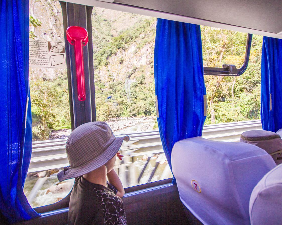 Boy enjoying the view as the bus drives up Machu Picchu mountain.