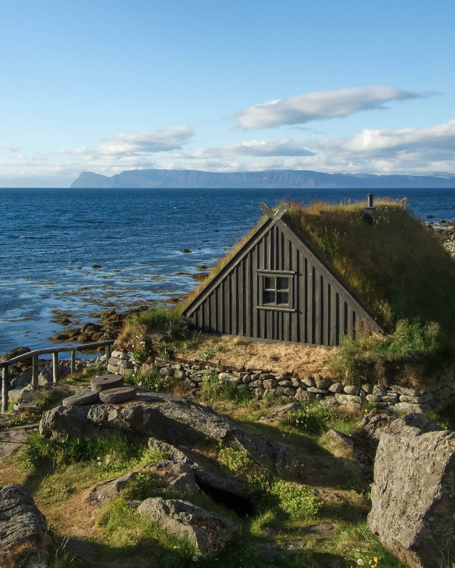 grass covered fishing huts on the coast of Iceland's westfjords