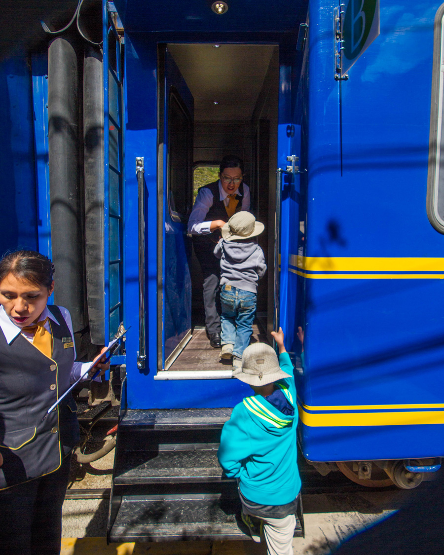 Boys boarding the Vistadome train of PeruRail for our trip to Machu Picchu with kids.