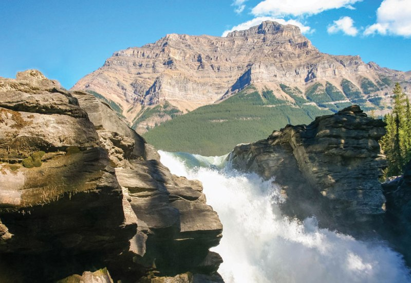 Waterfalls and rocky mountains make for amazing places to visit in Canada