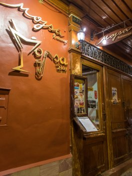 Entrance to Mojsa bar in Puno Peru. A great place to eat while visiting Lake Titicaca with Kids