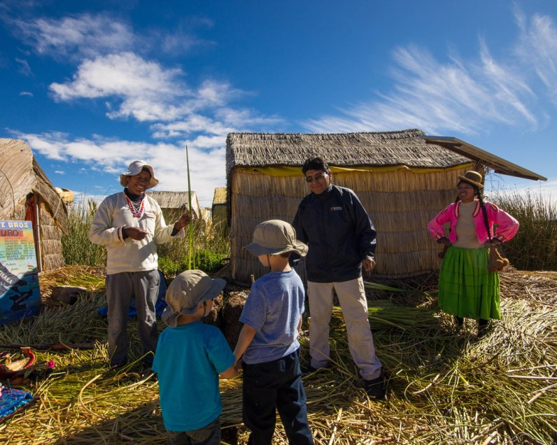 While visiting Lake Titicaca with kids, two young boys are shown how the reed islands of Uros are made by an indigenous elder.
