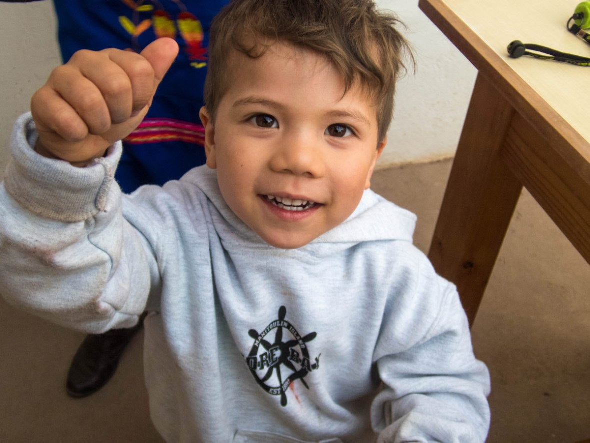 A young bou smiles for the camera after the Taller Ceramica workshop by Pablo Semniario where we experienced ceramics painting for kids