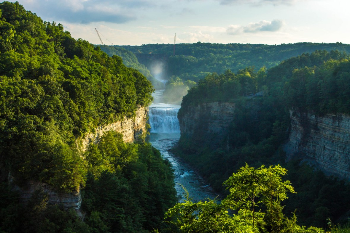 Sunlight lights up the gorge in Letchworth State Park with kids in New York State