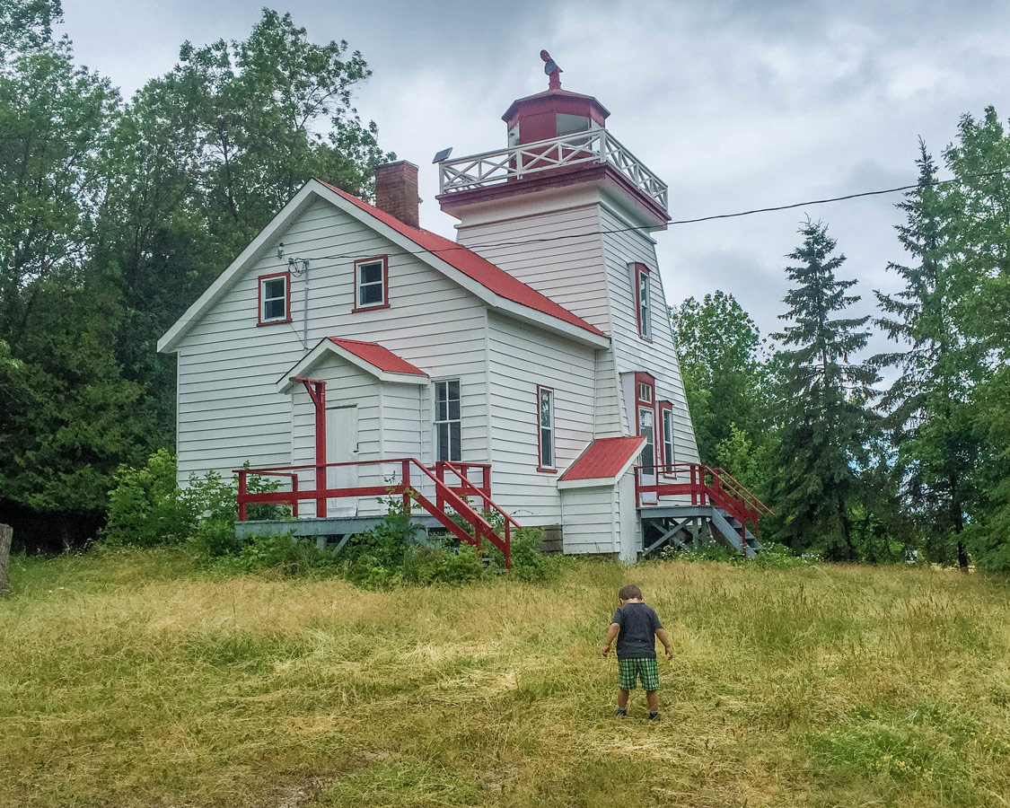 A young boy explores the grounds of the Janet Head Lighouse on Manitoulin Island. It's one of the best things to do on Manitoulin Island