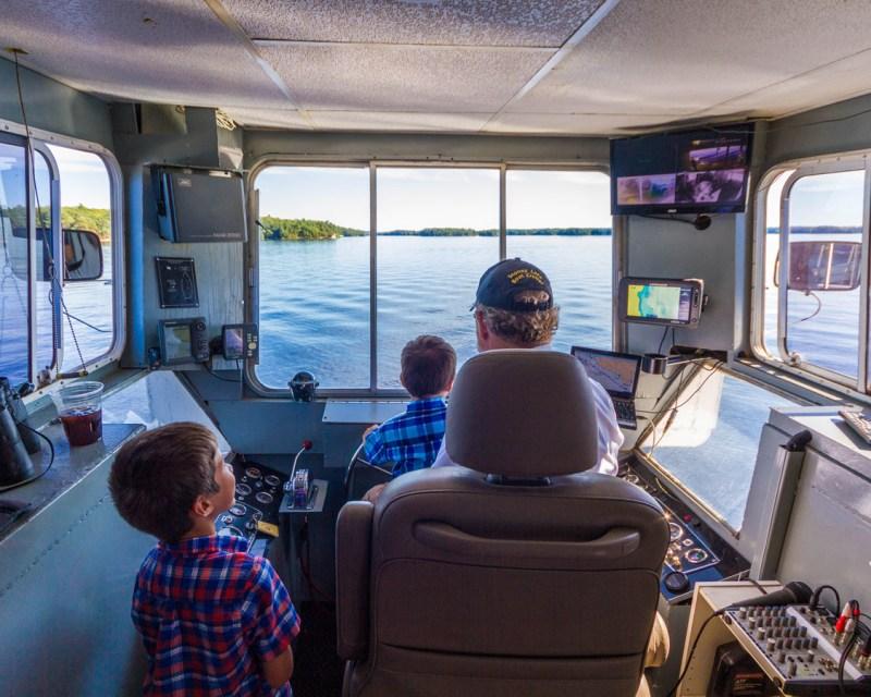 Boys check out the bridge of the Lady Muskoka cruise in Bracebridge Ontario