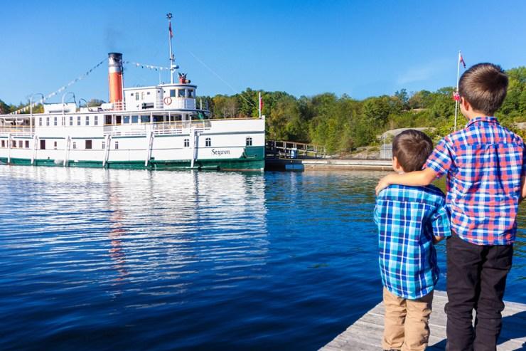 Watching the RMS Seqwun of the Lake Muskoka Steamships in Gravenhurst Ontario during a Lake Muskoka Steamship Cruise