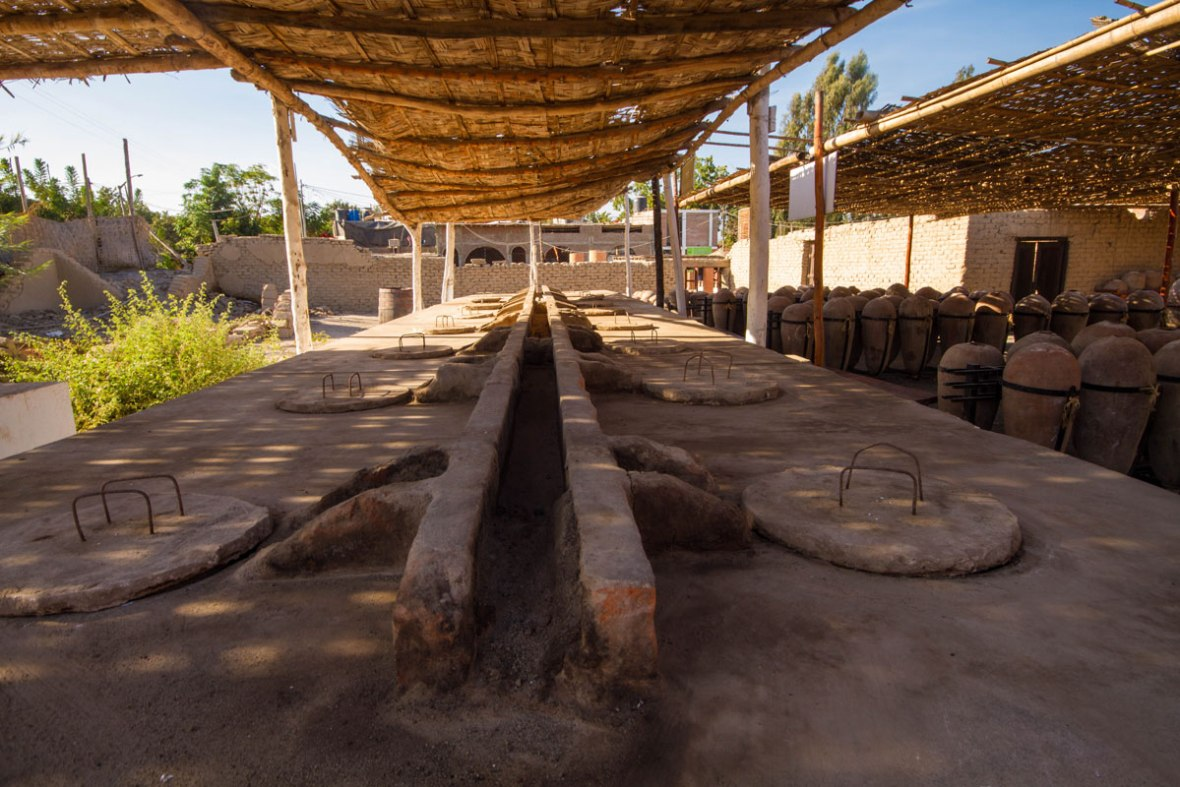 Wine distilling barrels for making Pisco Sours in Pisco Peru with kids