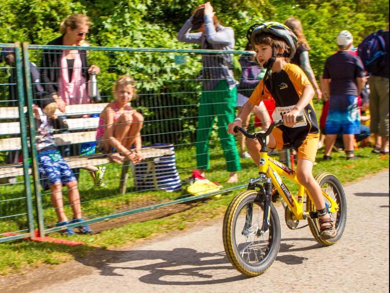 Boy rides bike during Shufelt Kids Triathlon in Peterborough Ontario