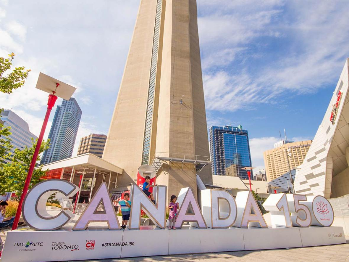 Canada 150 sign in front of the CN tower in Toronto Ontario