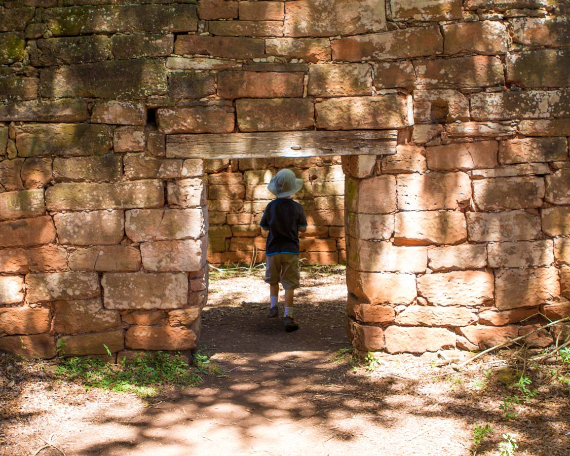 A young boy walks through the Jesuit Ruins of San Ignacio Mini
